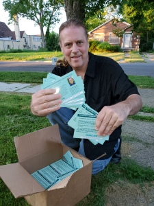 Scotty Boman with CAC information cards.